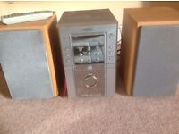 Sanyo CD Player and Radio AM and FM. Unit 25cm (H) x 25cm (d) x 16cm (high) plus 2 speakers. Working