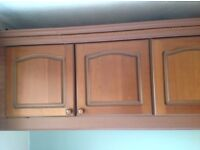 Schreiber fitted bedroom wardrobes with bedside units and over bed storage