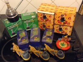 Electronic vacuum smoking pipes, Adult themed clay smoking pipes, Ash craft pipes and Rasta ashtrays