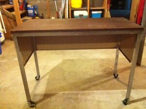 Office table on casters good condition.