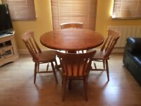 Solid pine circular drop-leaf table & four chairs