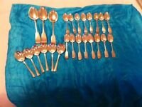 A large collection of old silver plates cutlery