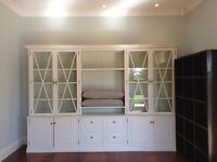 Bespoke white TV storage unit and bookcase with cupboards, shelves and drawers