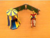 King on horseback , tent and fencing.