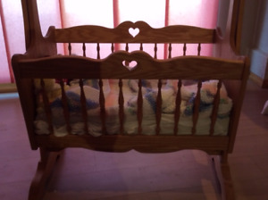 Wooden hand made rocking cradle