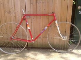 Red Peugeot bike frame and fork with wheelset