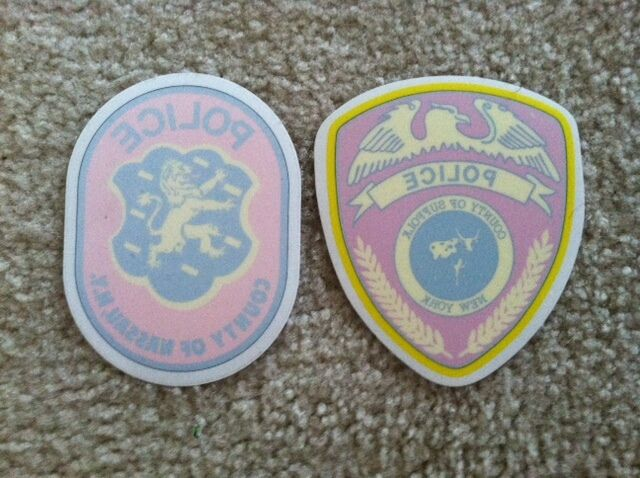 (1) INSIDE NASSAU COUNTY POLICE DECAL & (1) INSIDE SUFFOLK COUNTY POLICE DECAL