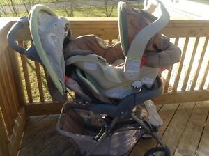 Graco Whinnie the Pooh Stroller with rear facing baby carseat
