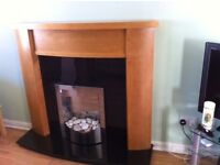 Beautiful Fireplace and Black Granite hearth and backplate