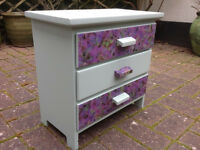 Upcycled small chest of drawers. Painted duck egg blue & purple flower decoupaged drawers.