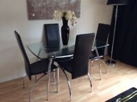 Contemporary Glass table and 4 Faux leather high back chairs