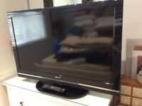 "Sony Bravia 40"" flat screen tele with stand and remote"