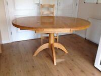 Oak extending kitchen/dining table. Modern design, light oak
