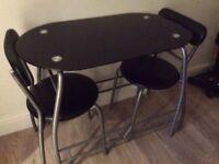 BLACK OVAL SHAPED GLASS TABLE