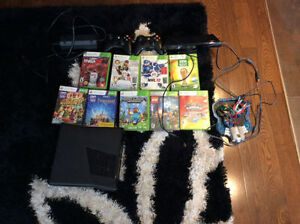 XBOX 360 + Kinect + 8 games + 2 controllers 180$