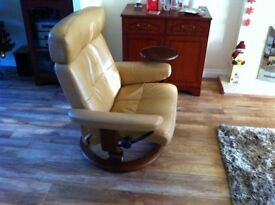 Ekornes Stressless Reclining Chair with adjustable headrest, small attached side table and stool