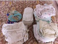 Bundle of reusable nappies, wraps, liners and two swim nappies too. Used but in very good condition