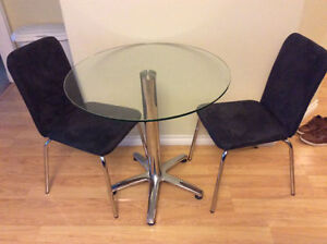 Glass bistro table with two chairs