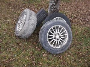 4 16- 225-60 all season tires on rims for chrysler intrepid