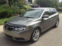 2011 Kia Forte5 Hatchback with warranty and winter tires/rims