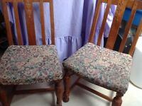 2 solid Oak Chairs. Tapestry upholstered seats in need of renovation.