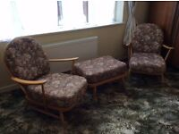 Blond wood genuine Ercol furniture set two armchairs and large stool. All in reasonable condition.