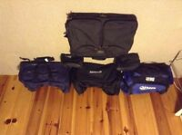 3 duffle bags, 2 toiletry bags and a travel suitcase