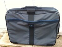 Suitcase Samsonite soft sided large size 60x70 x20 approx 4 wheels and handle. Excellent condition.