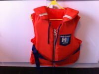 Life Jacket made by Helly Hansen, adult size and in good condition