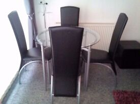 Glass dining table and 4 chairs from Next
