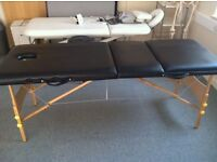 Black portable physio / massage couch