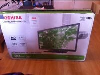 """HD LED Toshiba TV 32"""" in great condition a year old boxed"""