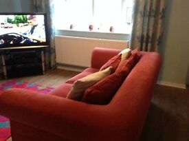 Large two seater M&S sofa rust colour £60