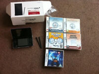 Nintendo DSi + 5 games + new charger with 3 adapters