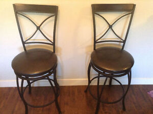 Two brand new swivel bar stools