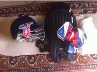 Set of cricket pads, helmet, keepers gloves and jumper. Suitable for boy 14 years up.