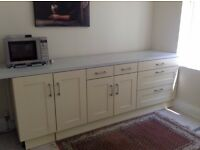 Cream shaker door kitchen units, integrated dishwasher and freestanding fridge freezer
