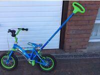Bike (starter bike) with removable push along pole.