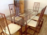 Glass and iron frame dining room suite, six chairs, matching unit and end tables