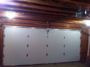 USED GARAGE DOORS WITH NEW HARDWARE INSTALLED