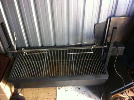 HEAVY DUTY ROTISSERIE SPIT IN GOOD CONDITION.