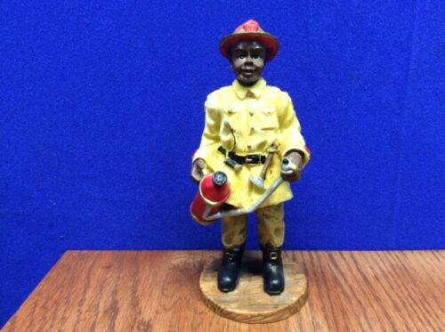 Black Americana Fireman with a Fire Extinguisher in hand ~ Figurine