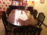 Regency style table and 8 chairs ( 2 carvers ) Table has claw feet.verey good condition.