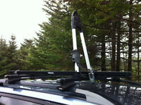 Thule roof rack with upright bicycle carrier attachment