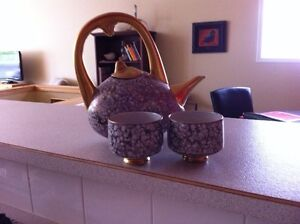 Teapot with matching cups