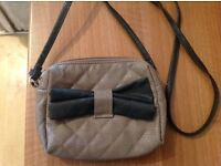 Small brown bag with black bow on the front - Good condition