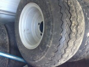 For sale: 7 good golf cart rims with tires.