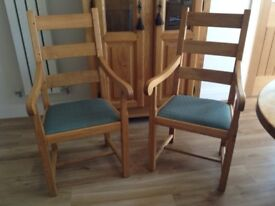 Oak carving pair of dining chairs. beautiful solid oak chairs. Can easily be recovered