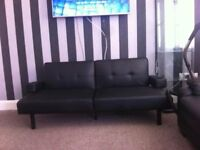 Black leather sofa bed £50 ono