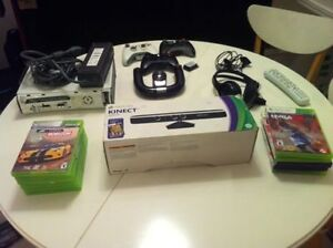 XBOX 360 with 5 Controllers, Kinnect and tons of games!
